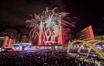 Fireworks explode during Year's Eve celebrations at Nathan Phillips Square in Toronto, Wednesday, Jan. 1, 2014. (AP Photo/The Canadian Press, Mark Blinch)